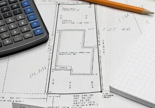 Close up of a property survey on a messy desk