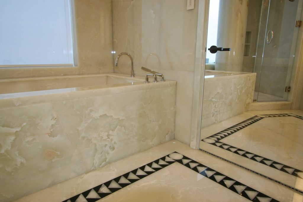 Master bathroom floor and walls in white onyx and belgium black marble slab