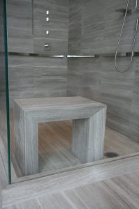 His Bathroom in woodstone with custom slab bench