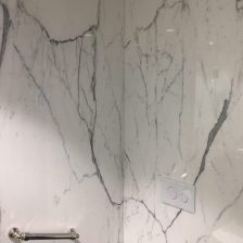 Master bathroom calacatta marble slab walls