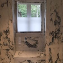 Paneled shower window bench niche in paonazzo white marble