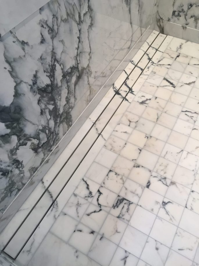 Shower floor linear drain in paonazzo marble