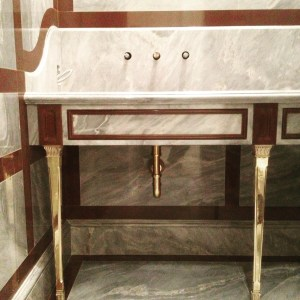 Powder room with Red and Gray marble vanity with PE Guerin bronze legs