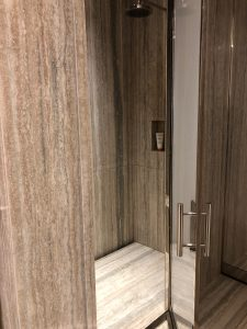 Master bathroom shower in silver travertine