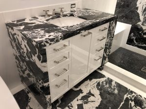 Children's bathroom in grand antique and white dolomiti marble
