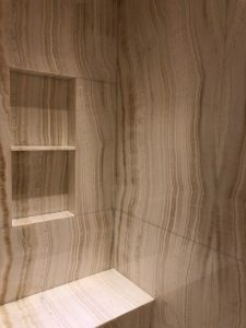 Her Bathroom shower walls and niche in Ivory onyx slab