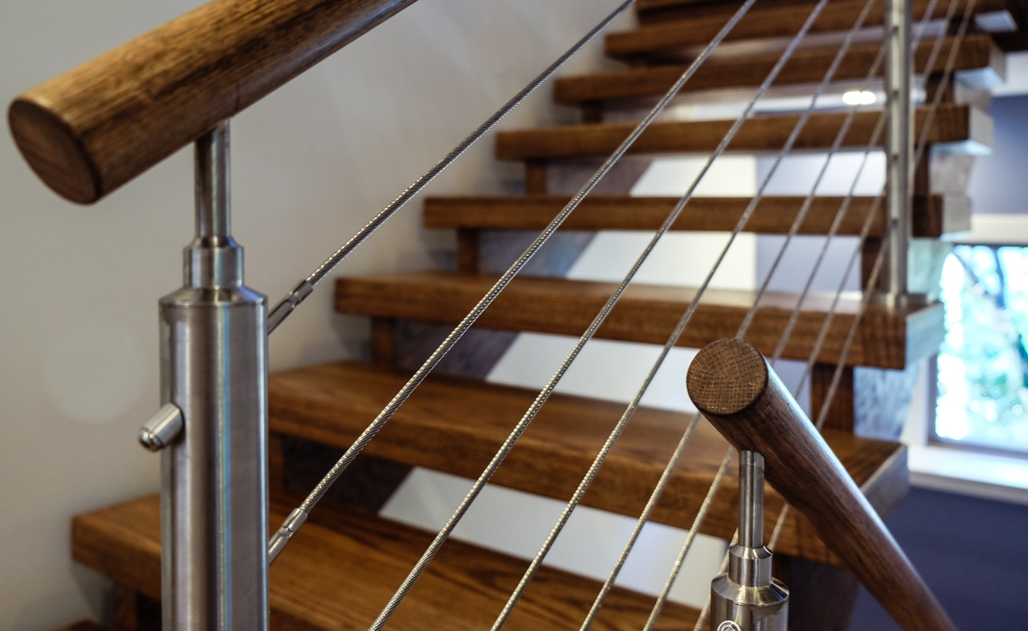 How Cable Railings Are Transforming The Staircase Market | Modern Cable Stair Railing | Stainless Steel Stair | Railing Systems | Glass Railing | Entry Foyer | Staircase Remodel