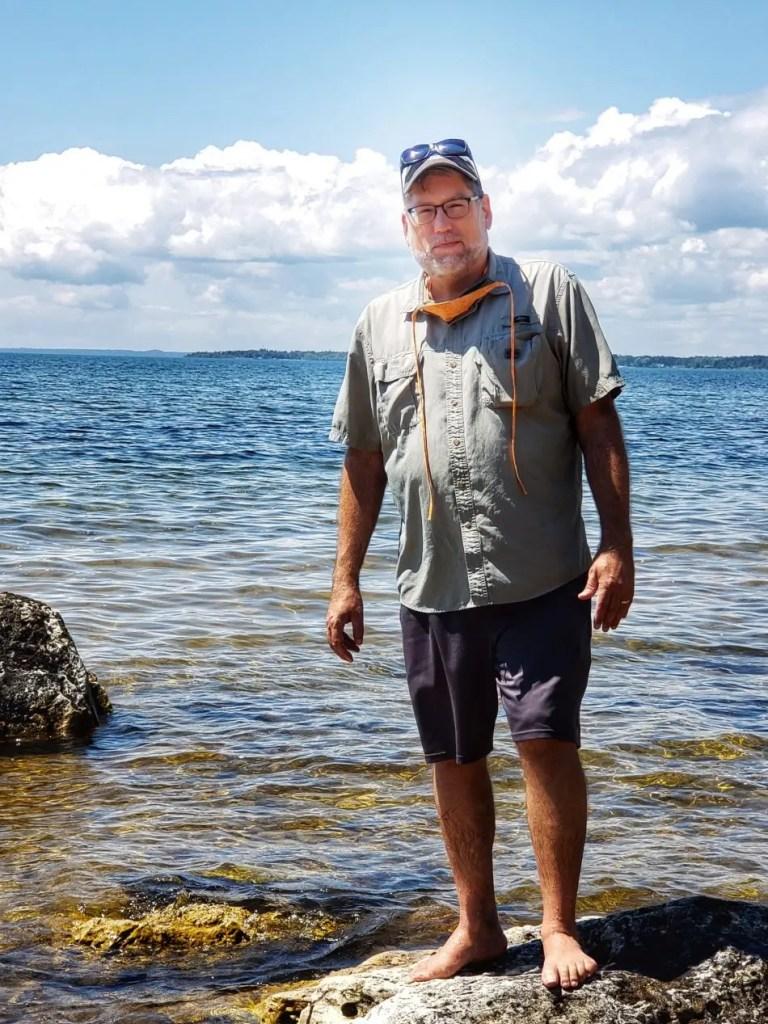 a Photo of the Artist Wading in Lake Michigan Near Naubinway