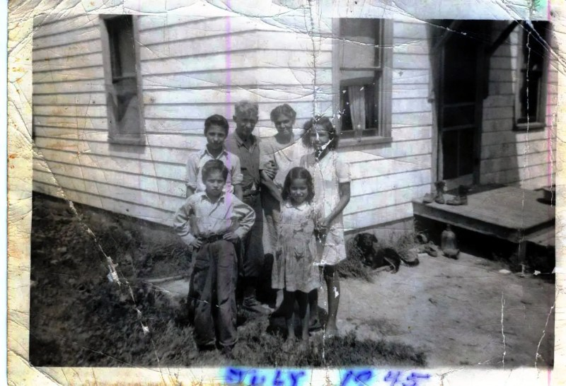 An old black and white photo of the Matthews Family at their home near the Silver River Access Road