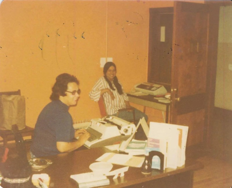 An old photo from the seventies of two native woman working in an office