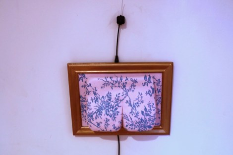 Title:Booty Medium:	Acrylic and Goldleaf on Ceramic, Camera, Wires, and surveillance video feed Size:	7x5x5