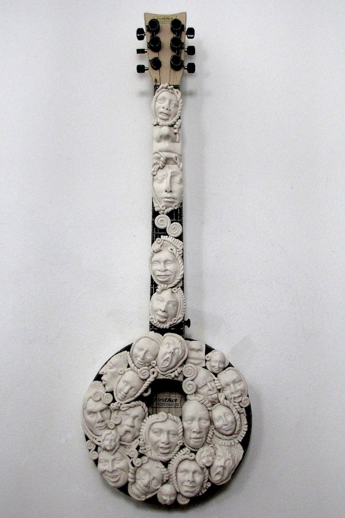 Title:With A Banjo on My knee Medium:recycled found objects Size:31 x 11 x 5