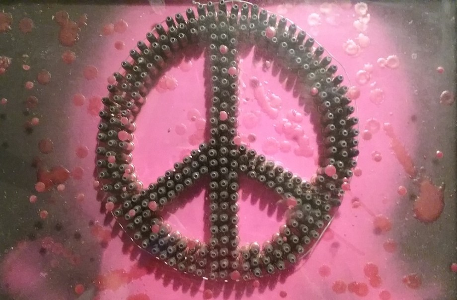 """Title:we must have Peace Medium:shadow box, wax, bullets Size:11""""x14"""""""
