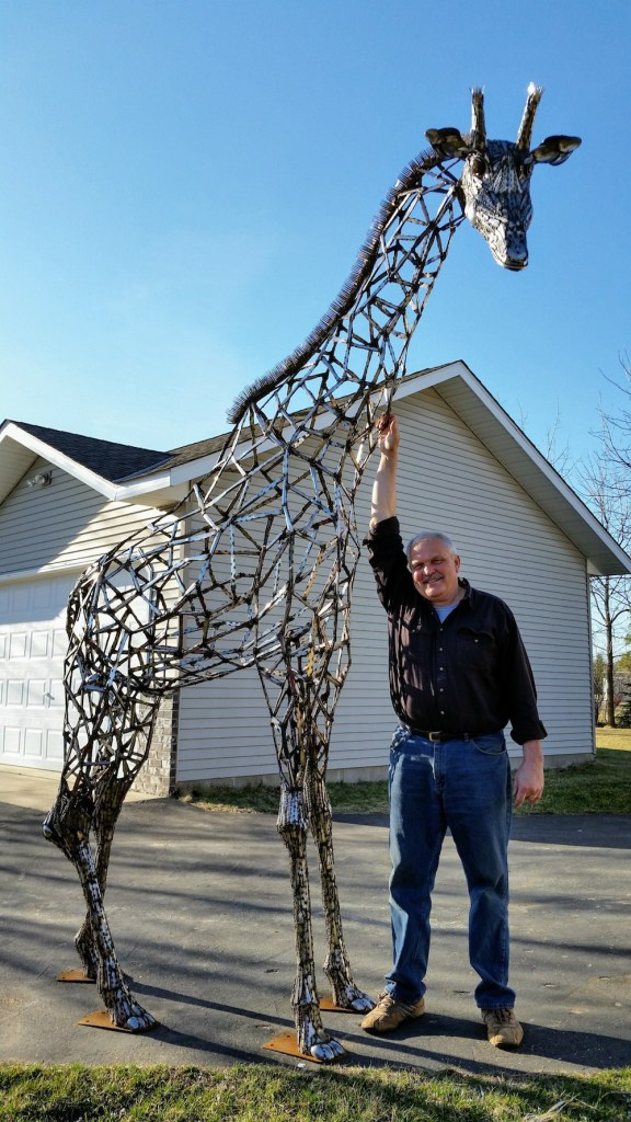 Title:Out Of Africa Medium:Stainless Steel Flat Ware Size:12 feet tall