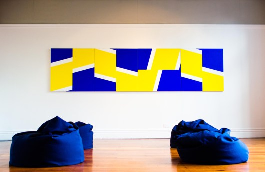 'PRISMISM'. Enjoy Public Art Gallery, 2014. Installation detail featuring: 'Futurist Painting for GCSB Boardroom' (2012-13); 'Four Eyes' (with Nick Sala) (2014), 4 custom made canvas bean bags, dimensions variable. Photograph: Oscar Perry & Enjoy Gallery.