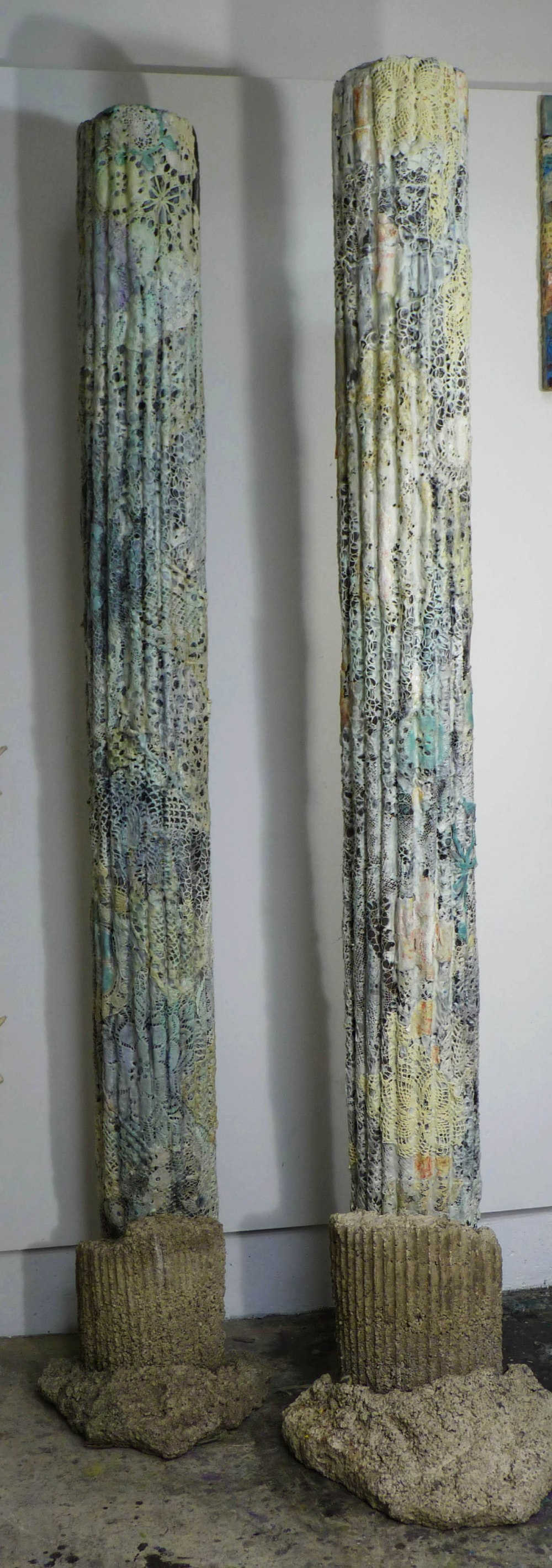 "Creature Columns: 8' x 18"", cast paper over sono tube, cast concrete base, lace, wax, oil."