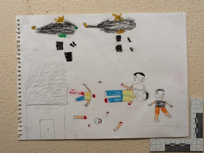 """Two planes drop bombs on the people. The children are crying, and the father has lost his hands."" Drawing by Syrian girl."