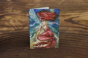 greeting card or note card featuring watercolor mermaid fairy by sea