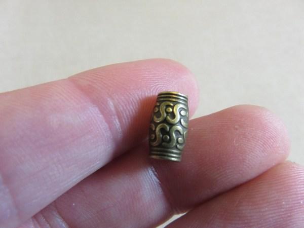 Perles colonne bronze gravé ethnique 12x7mm - lot de 10
