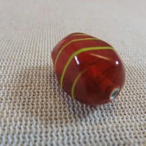 Perle verre Lampwork orange tréfilé jaune forme irrégulière