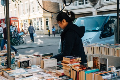Samantha Huang finding books for her installation