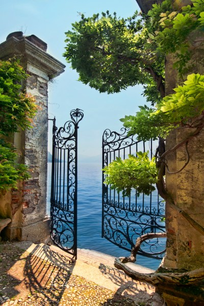 Fine art photography of a private gate leading to Lake Como in Italy