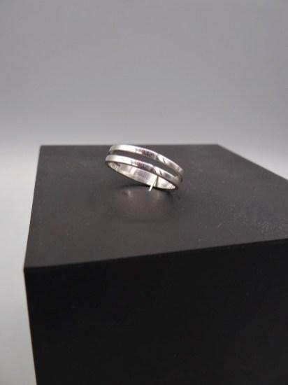 Arto Edelsmeden- Zilveren ring ingezaagd