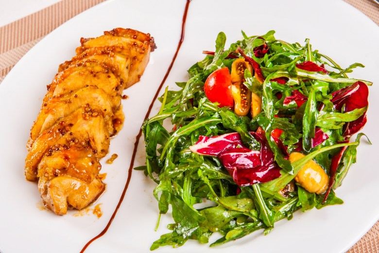 Chicken breast and salad with mixed greens