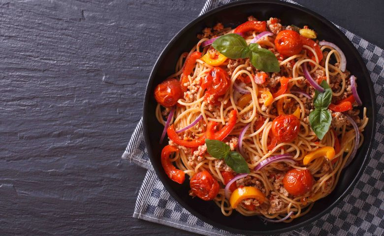 Beautiful spaghetti with minced meat and vegetables, top view