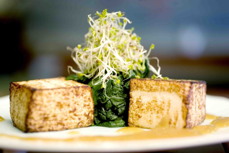 Tofu cubes with blanched spinach with bean sprouts and soy sauce