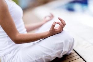 Yoga-woman-meditating-and-maki-46483552