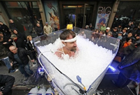 Wim Hof stands in a container of ice