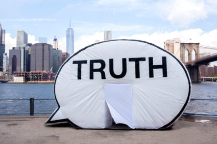 """The Truth Booth"" by the Brooklyn Bridge. The booth, by the Cause Collective, is heading to Cleveland for the Republican National Convention. Credit Ben Pettey"