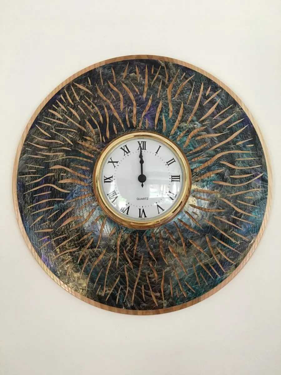 Woodturned ash clock with dye and carvings
