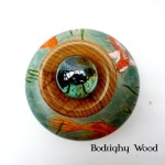Top down view of a vase colored and burned with pyrography to look like a koi pond.