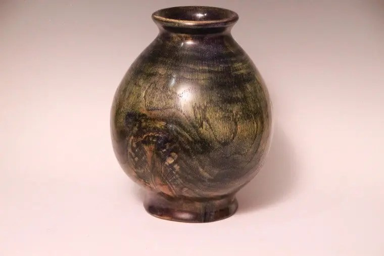 Chestnut vase hollow form woodturning.