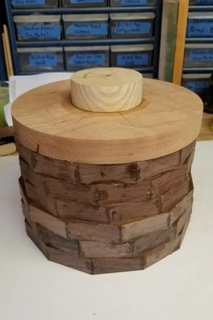 Wood pet urn being made from several wood pieces glued together before woodturning