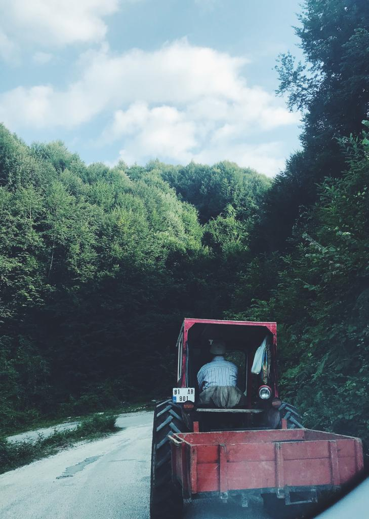 Local farmers riding in a tractor in Düzce