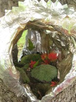 """Tree Installation"" by Bettina Turner ( duct tape,spray paint. moss, sapling)"