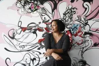 "Artist Shinique Smith seated in front of her 2008 work ""Especially In The Afternoon."" (Courtesy Keith Bedford/Museum of Fine Arts, Boston)"