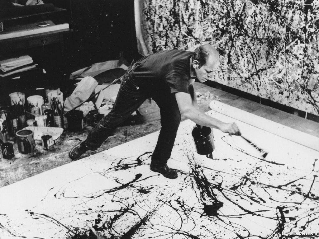 Jackson Pollock painting with his style of Drip Painting