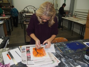 Lisa Egan working with leaves