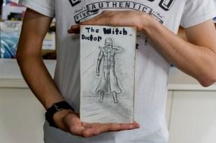 Daniel McLachlan holding his 9 x 5 artwork. Photo by Rob Cox