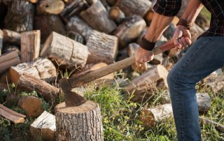 Man chopping wood with an axe
