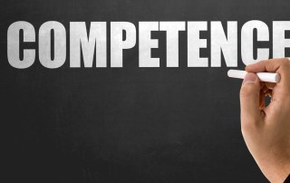 """The word """"competence"""" on a blackboard"""