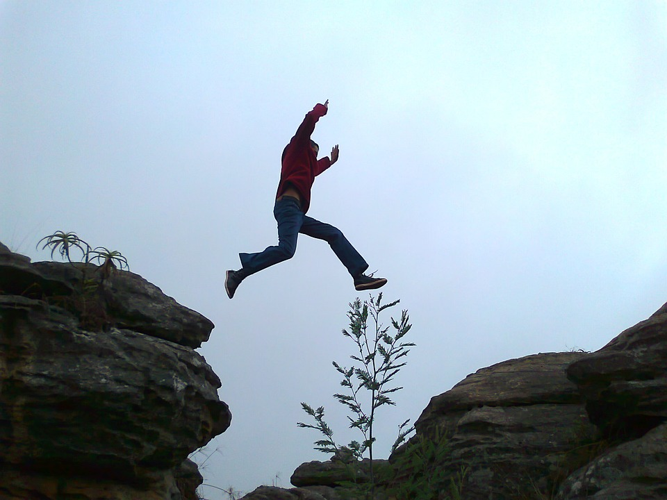 Person Leaping Across Gap