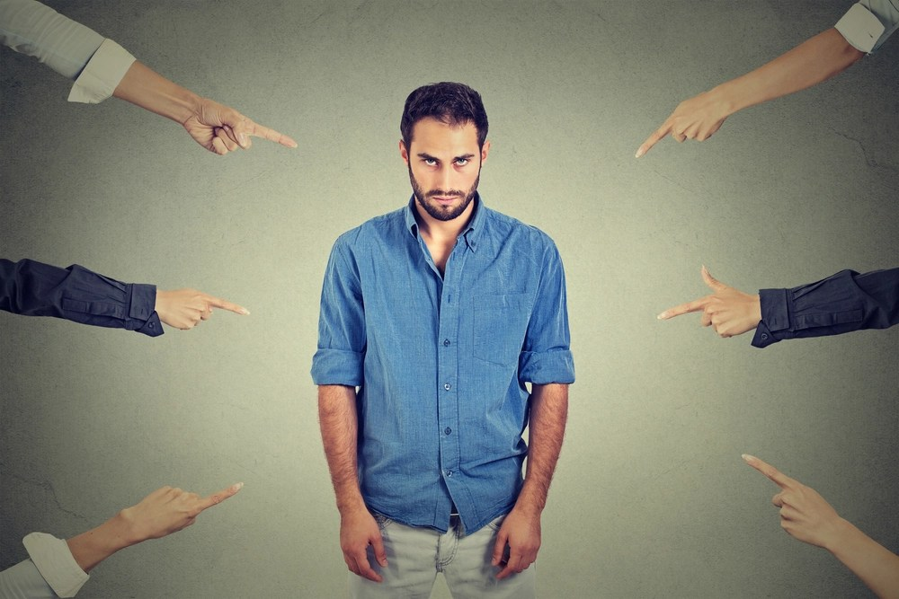 Upset man with fingers pointing at him