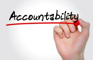 "Word ""accountability' written on whiteboard"