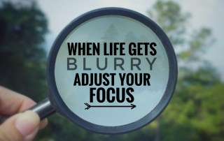 Magnifying glass with words reading: When life gets blurry, adjust your focus