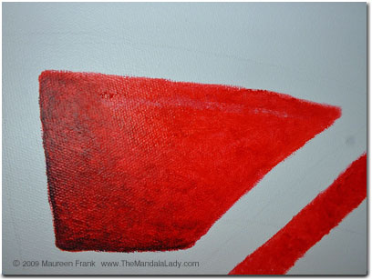 1 of the 4 outer red shapes
